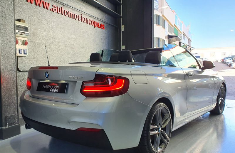 BMW Serie 2 218d Cabrio vista trasera y lateral derecho descapotado