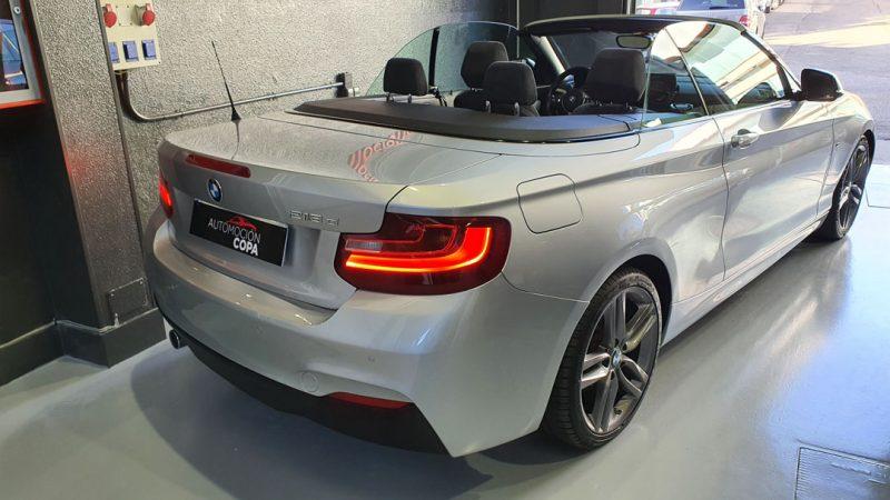 BMW Serie 2 218d Cabrio vista trasera y lateral derecho desde arriba descapotado